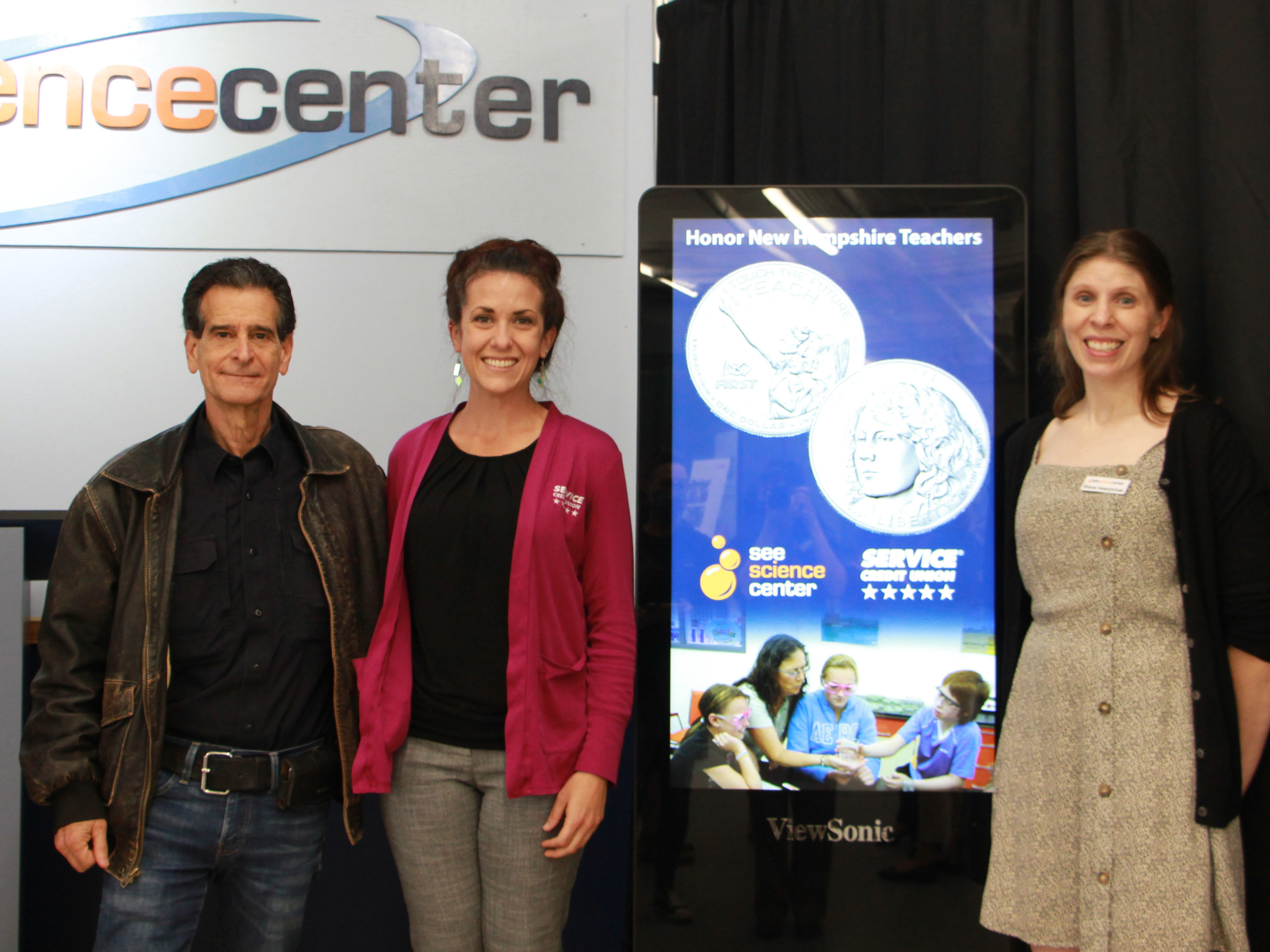 Dean Kamen and Jamie Yates representing sponsor Service Credit union poses with SEE director Shana Hawrylchak at the program launch.